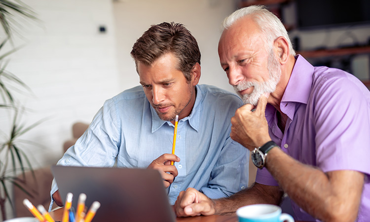 Two men looking at a computer